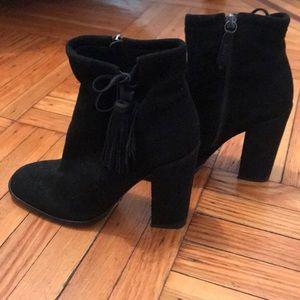 Bishop tasseled suede ankle boots.